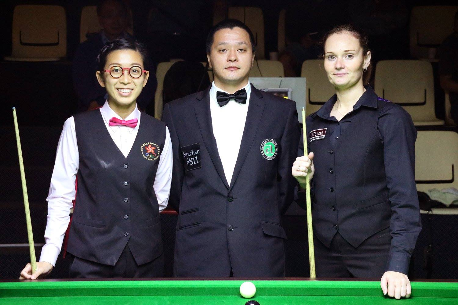 Reanne Evans and Ng On Yee stand next to referee