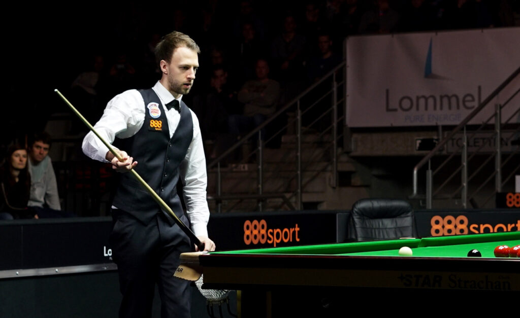 Judd Trump prepares to play snooker shot in Belgium