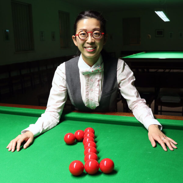 On Yee poses next to balls shaped as 1